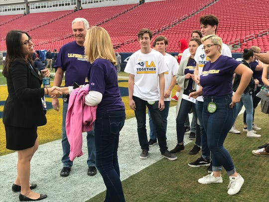 Members of the Cal Lutheran University choir arrive at the Coliseum on Monday afternoon ahead of their national anthem performance before the Rams' win over Kansas City on Monday night.