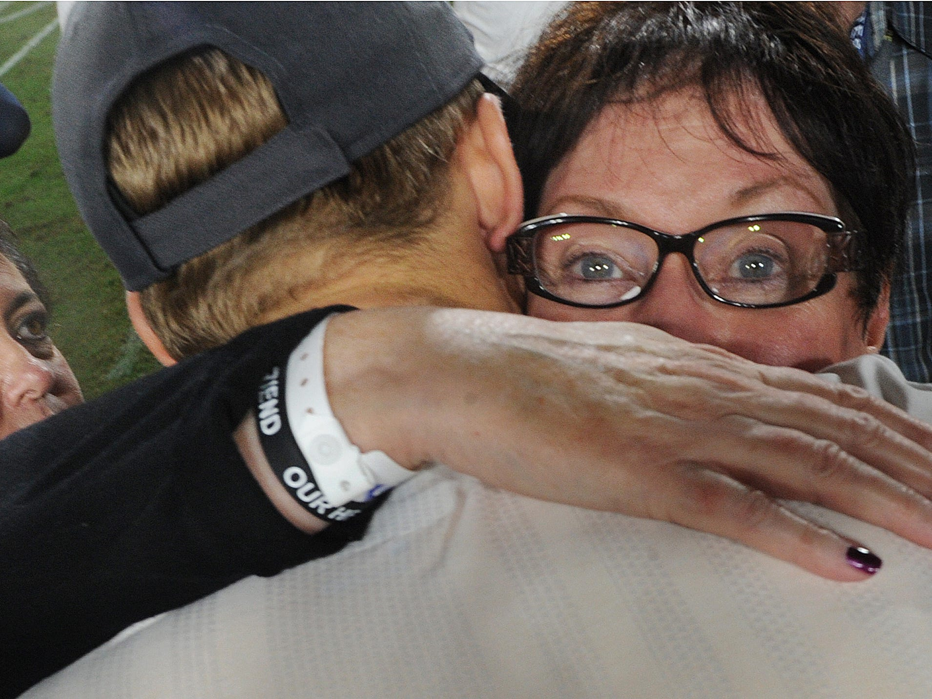 Rams quarterback Jared Goff, hugs Pam Archie, right, mother of Karen Helus, left, who is the wife of Ventura County Sheriff's Department Sgt. Ron Helus, after the Monday night's game against the Chiefs. Sgt. Helus was killed at the Borderline Bar & Grill shooting.
