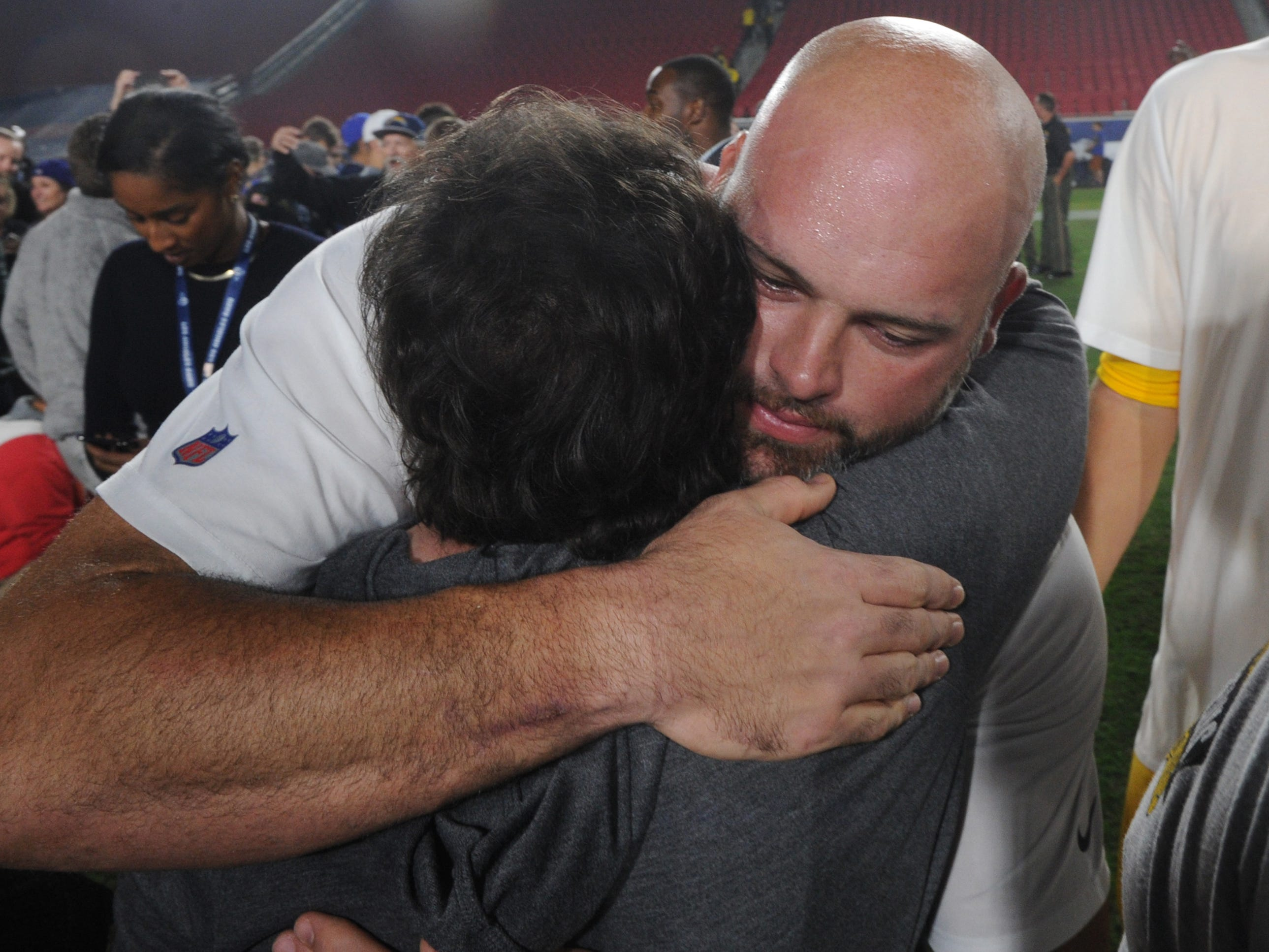 Rams offensive tackle Andrew Whitworth hugs Karen Helus, wife of Ventura County Sheriff's Sgt. Ron Helus, after Monday night's game against the Kansas City Chiefs at the Coliseum. Sgt. Helus was killed in the Borderline Bar & Grill shooting. The Rams honored the family of the victims and also the first responders to the shooting and recent wildfires.