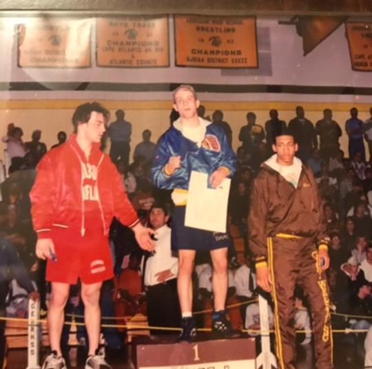 Jon Forster, center, Buena wrestler