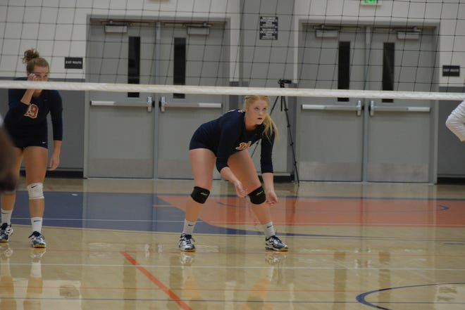 COS volleyball player Christa Pilgrim gets ready for a play in a match earlier this season.