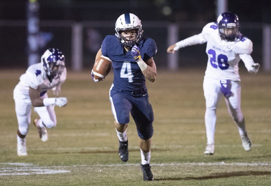 Central Valley Christian's Jaalen Rening runs against Washington Union in a Central Section Division IV quarterfinal high school playoff on Friday, November 9, 2018.