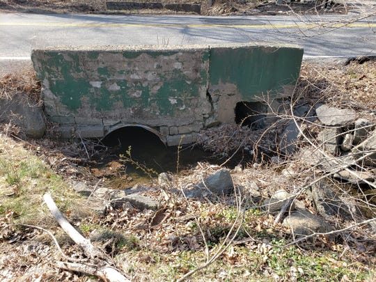 The culvert at a brook under Town Line Road in Orangetown will be replaced with a new precast box culvert.