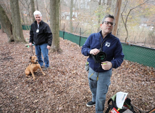 Pet Photographer Geoffrey Tischman, right, from Rye, prepares for a photo session at the SPCA of Westchester in Briarcliff Manor, Nov. 20, 2018. Behind him are volunteer Mike Waszmer with 6-year old Bruiser.