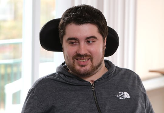 Tommy McGuire in his Haverstraw home Nov. 20, 2018. He continues to recover from a spinal injury after a swimming accident. The annual Tommy Turkey bowl fundraiser will be held Nov. 24 at Clarkstown South High School.