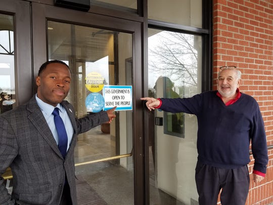 Spring Valley Mayor Alan Simon, right, and Trustee Eudson Francios  stand at the front door of Village Hall in January 2018 a month after taking office.