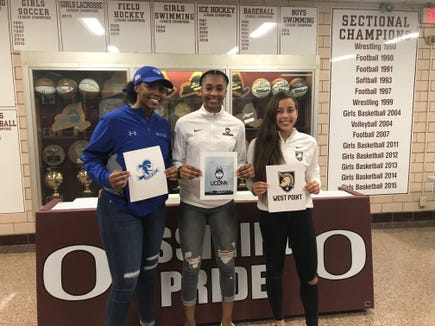 Ossining girls basketball players Kailah Harris (left), Aubrey Griffin (center) and Jaida Strippoli (right) signed National Letters of Intent to play Division I college basketball on Nov. 20, 2018.