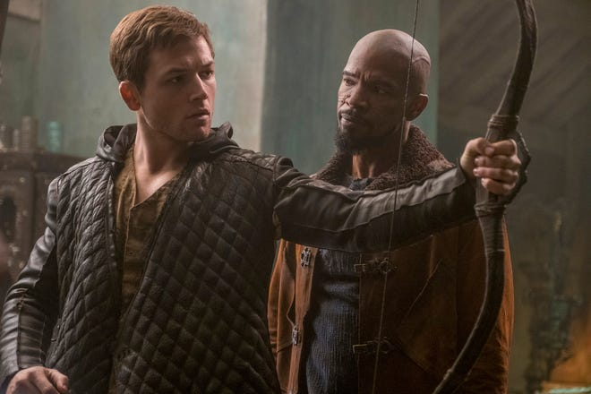 "Robin (Taron Egerton, left) and John (Jamie Foxx) in ""Robin Hood."""