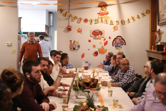 Residents and alumni of Limen House take part in a Thanksgiving meal - an annual custom at the residential addiction recovery center in Wilmington - a week before the rest of the nation.