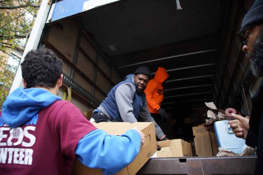 Volunteers help unload turkeys at Baynard Apartments, one of Norman Oliver's stops on his turkey giveaway to assist families and seniors. This year's turkey goal was to provide over 6,000 families with turkeys in Wilmington, as well as New Castle, Kent and Sussex counties.