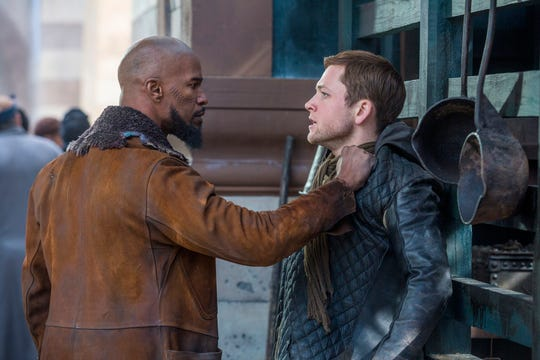"John (Jamie Foxx, left) and Robin (Taron Egerton, right) in ""Robin Hood."""