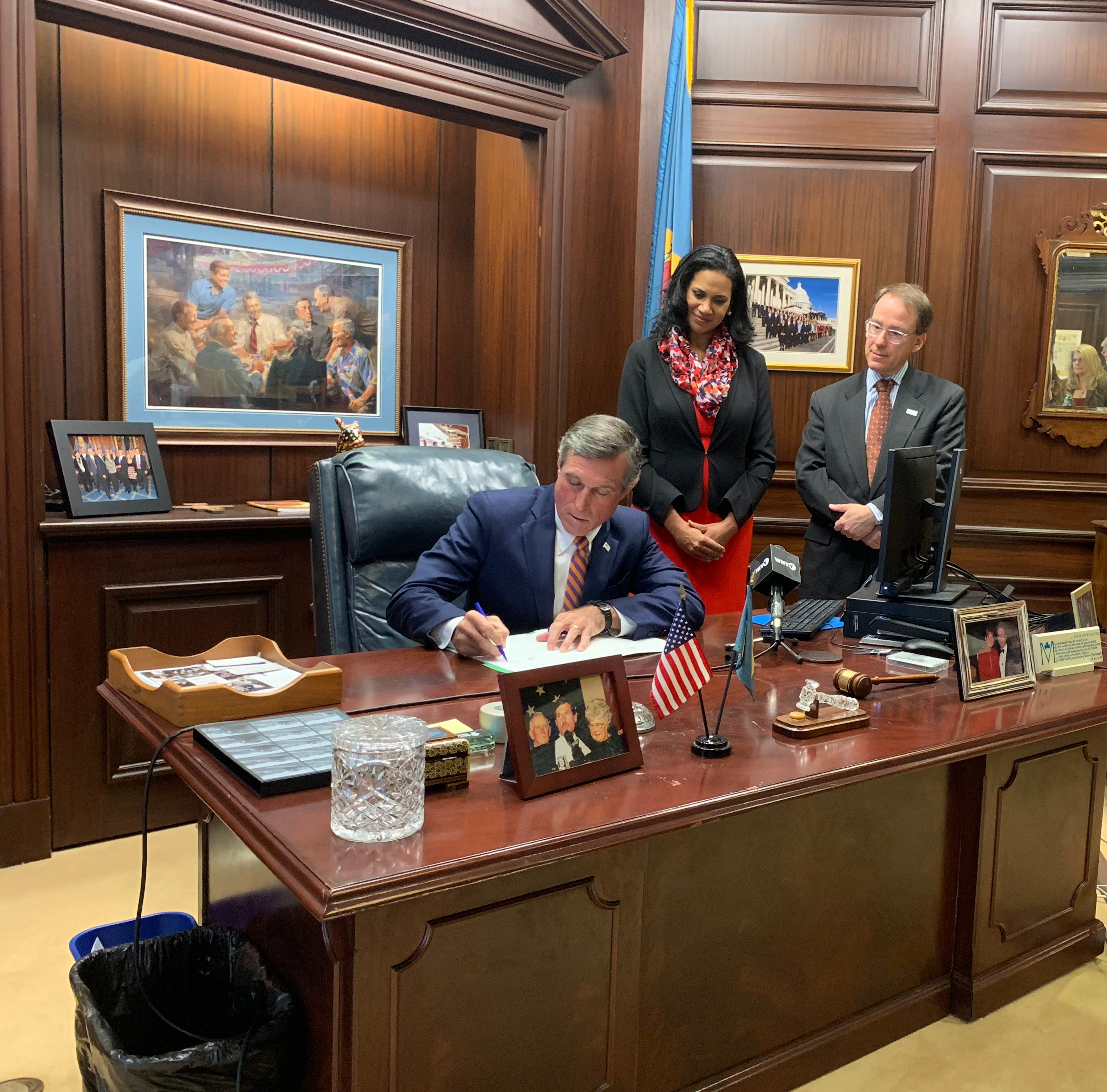 Gov. John Carney signs an executive order Tuesday that seeks to limit the growth of health care costs in Delaware.