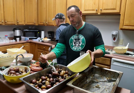 Don Glick, an alum of the Limen House residential addiction recovery center program in Wilmington, helps prepare a Thanksgiving meal for residents, staff and other alumni last week. The meal is meant to give everyone the opportunity to share their gratitude together a week before the rest of the nation gives thanks.