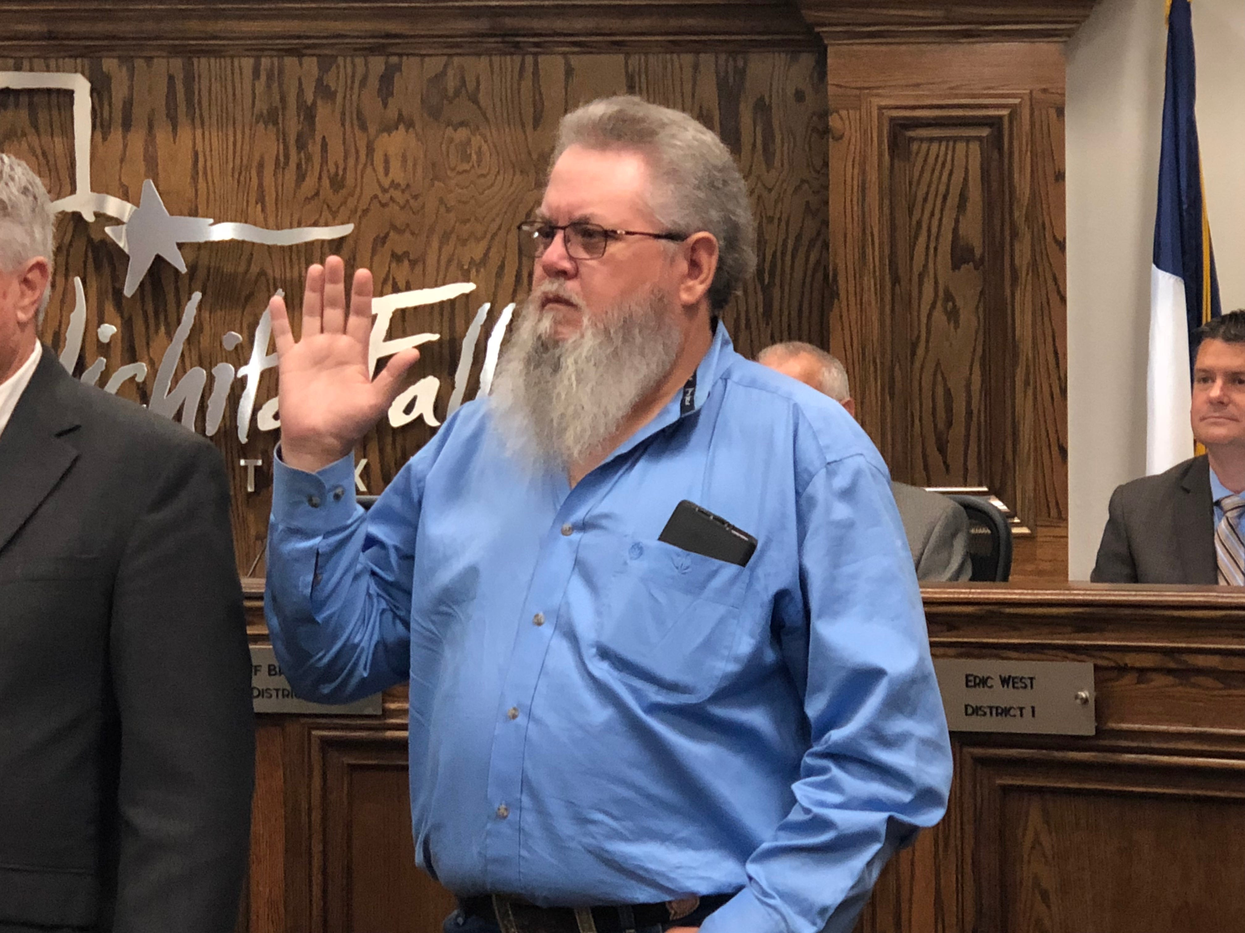 Newly elected Councilor for District 5 Steve Jackson takes the oath of office Tuesday.