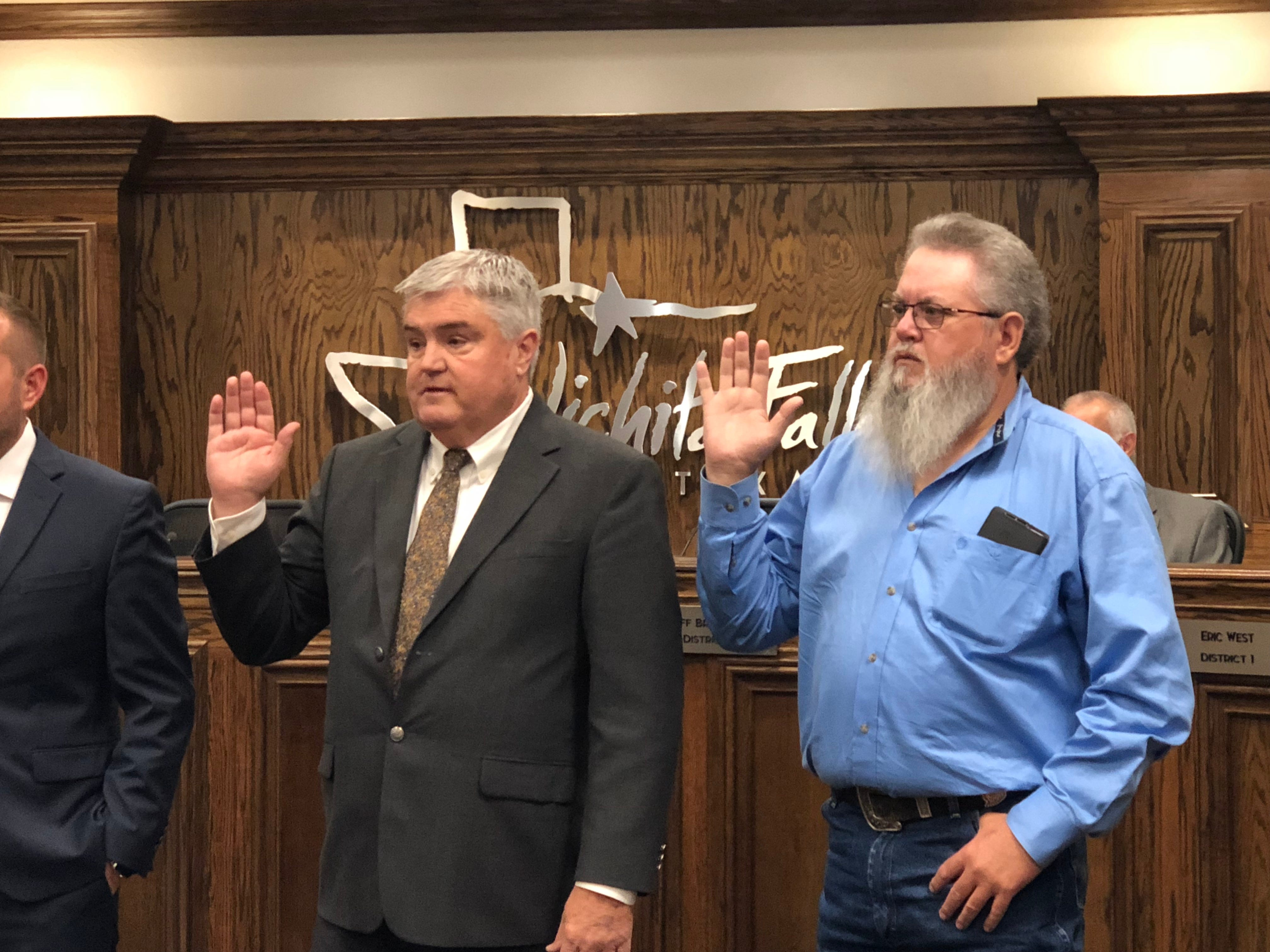 Newly elected councilors Tim Brewer, left, and Steve Jackson take the oath of office Tuesday.