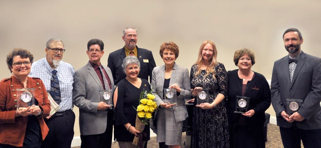 The 2018 MSU Texas distinguished alumni honorees including the year's SPIRIT winner and MSU Provost and Vice President for Academic Affairs James Johnston behind the group.