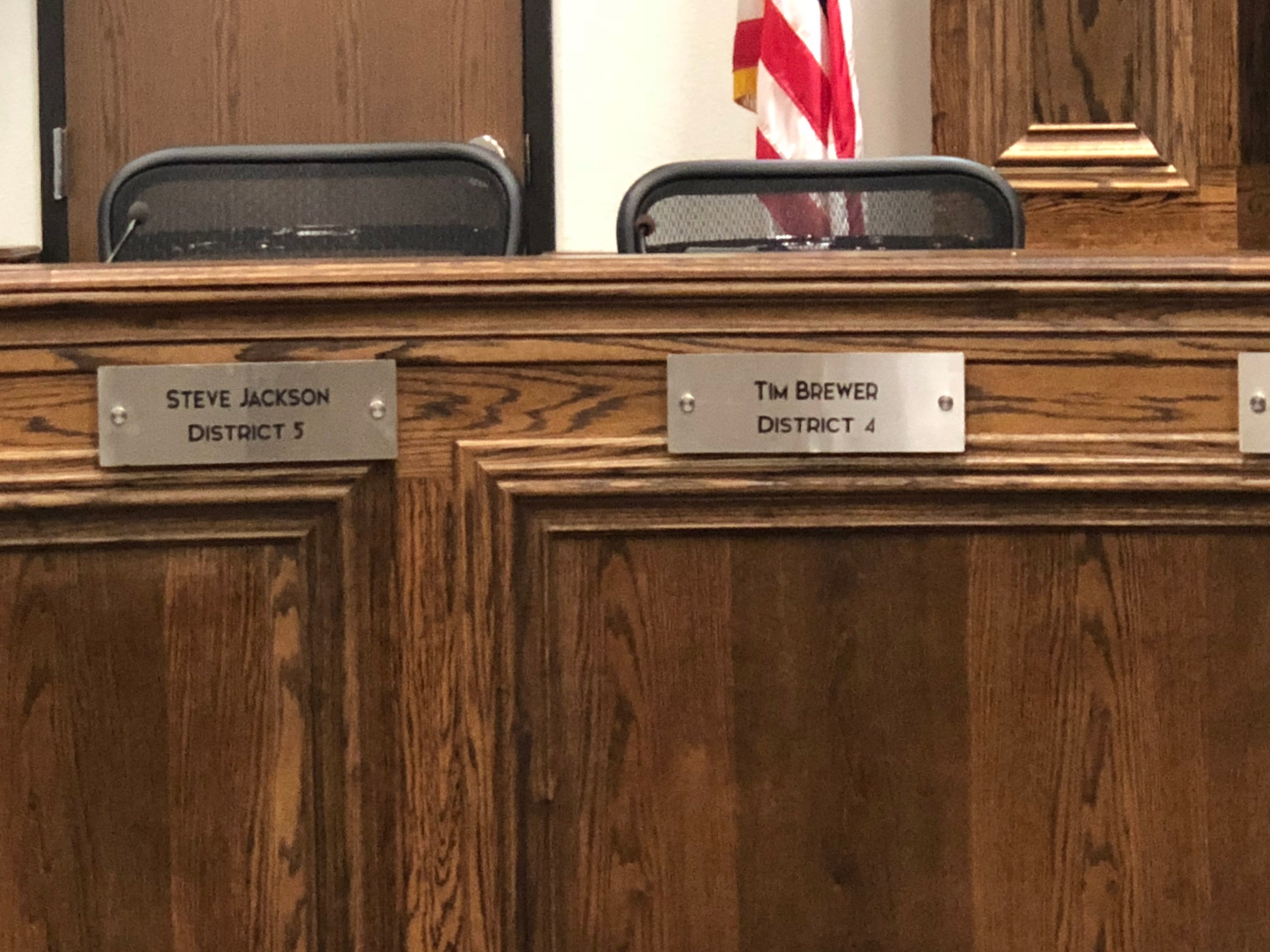 Name plates are seen Tuesday for newly elected councilors Steve Jackson, District 5, and Tim Brewer, District 4.