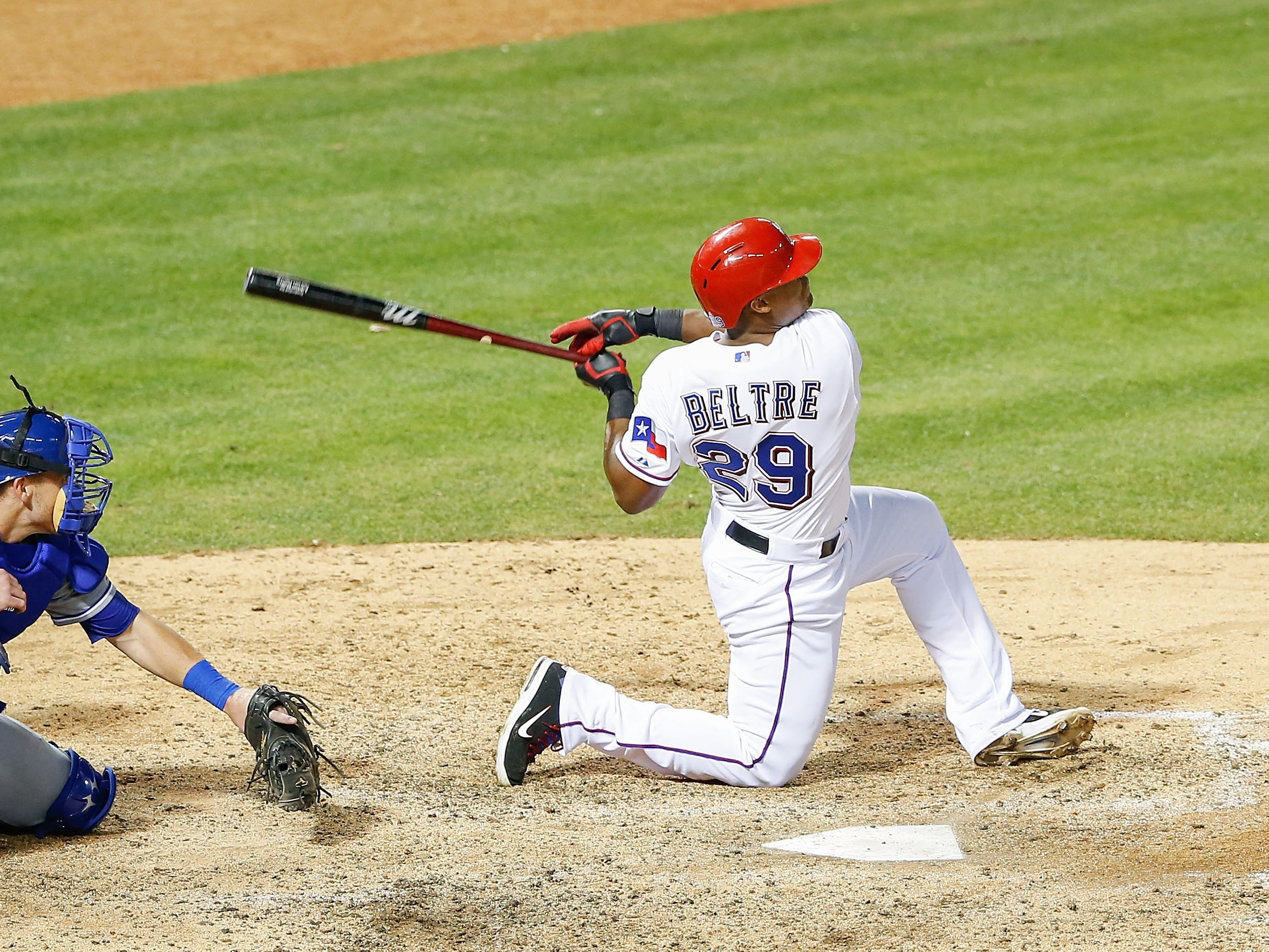 Beltre delivers one of his trademark home runs from a kneeling position. The right-handed hitter finished his career with 477 bombs and 1707 RBI.