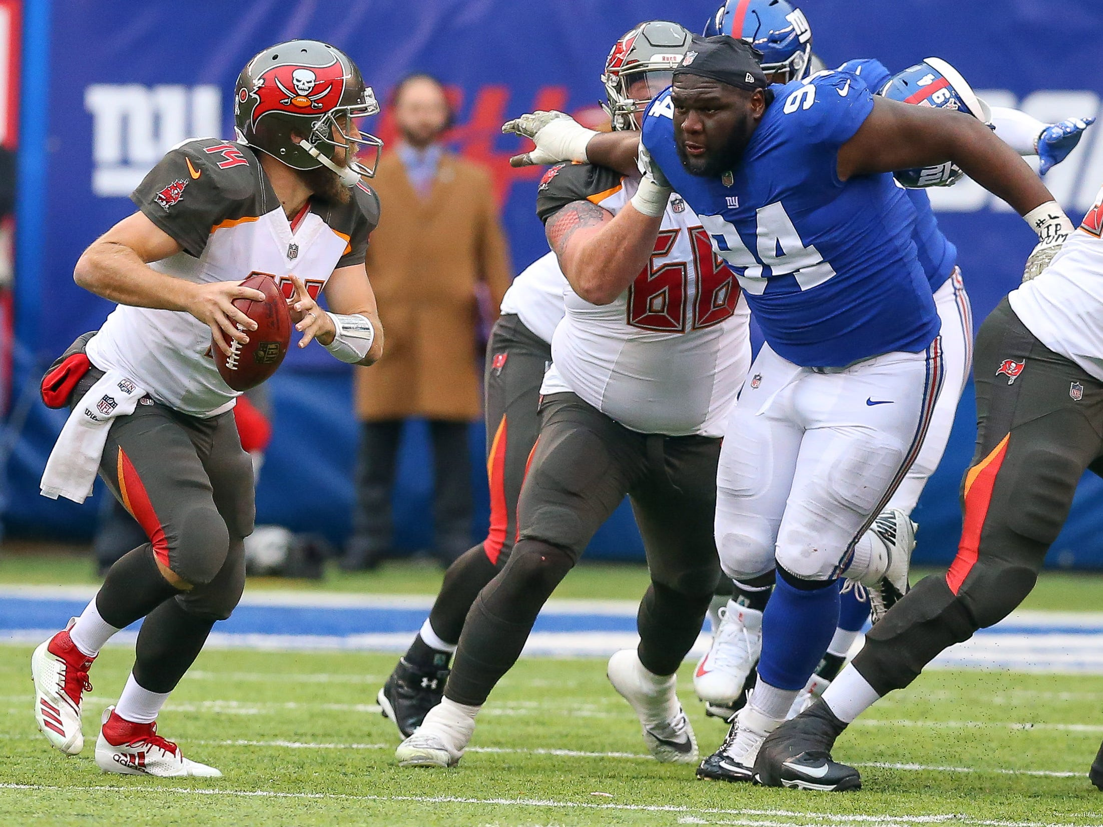Week 11: Tampa Bay Buccaneers quarterback Ryan Fitzpatrick is pursued by New York Giants defensive end Dalvin Tomlinson during the first half at MetLife Stadium. The Giants won the game, 38-35.