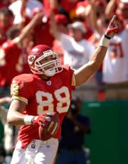 Kansas City Chiefs tight end Tony Gonzalez celebrates after scoring a touchdown on a 20-yard pass from Trent Green in the first quarter Sunday, Oct. 5, 2003, at Arrowhead Stadium in Kansas City, Mo.