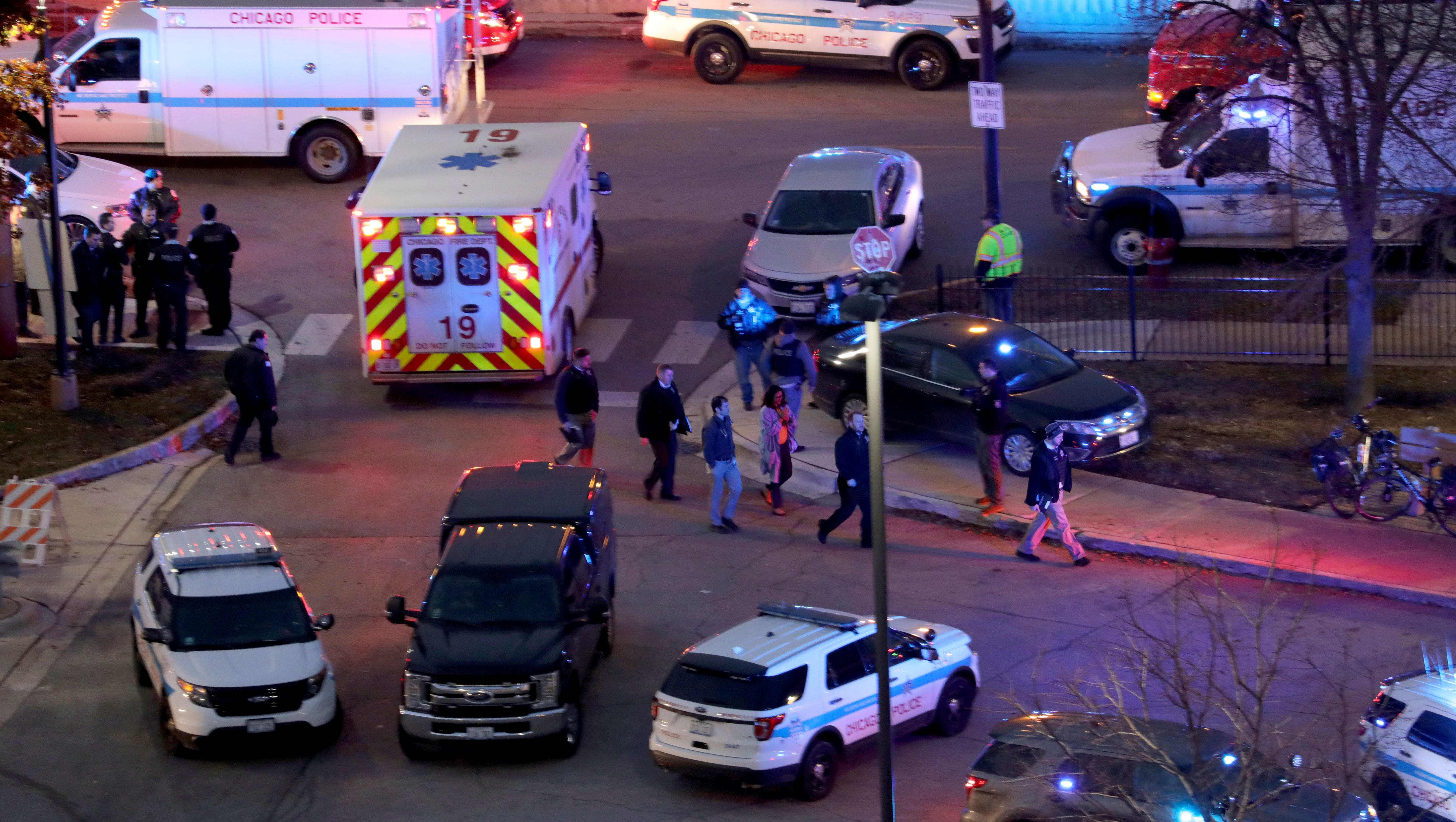 Law enforcement officials work near Mercy Hospital in Chicago, Monday, Nov. 19, 2018. A shooting at the Chicago hospital left four people, including two hospital workers and a police officer, dead.