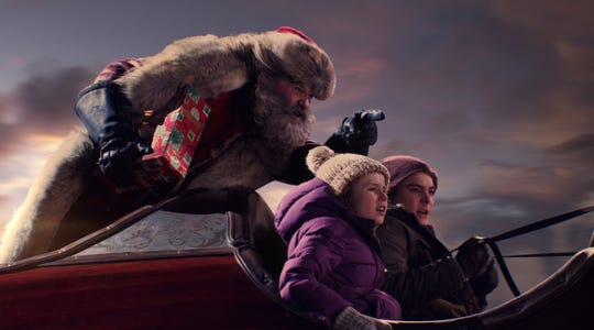 "Santa Claus (Kurt Russell, left) gets a couple of new helpers (Darby Camp and Judah Lewis) in ""The Christmas Chronicles."""