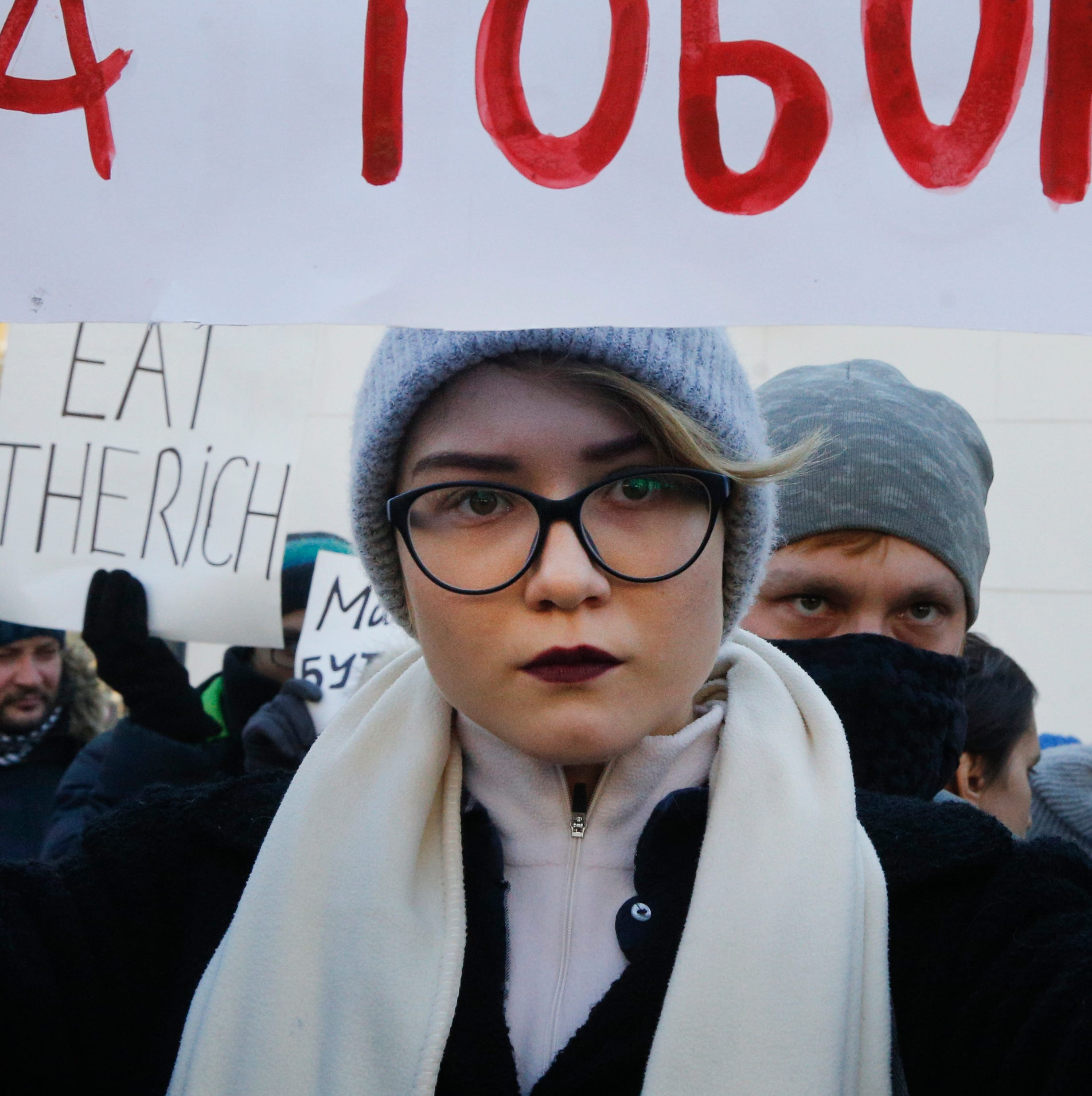 "A young woman attends a gay and lesbian rally a few days before the International Transgender Day of Remembrance in Kiev, Ukraine, Sunday, Nov. 18, 2018. Writing on the poster reads: ""If you stay silent, they will come for you, too."" The day is observed annually in Ukraine to memorialize those who have been murdered as a result of transphobia. Amnesty International in Ukraine has warned on the growing violence against sexual minorities from radical groups."