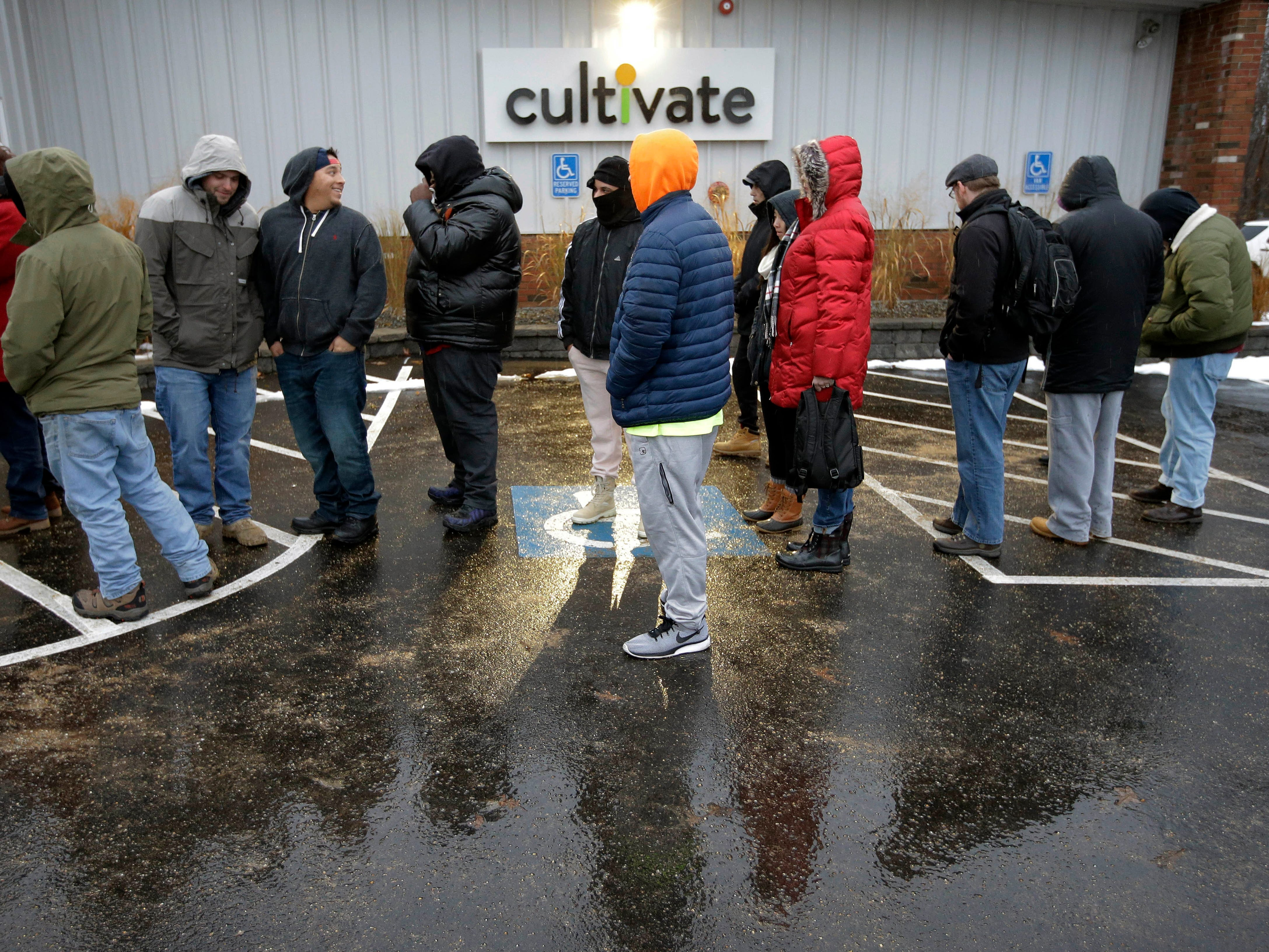 Customers wait outside the Cultivate cannabis dispensary to purchase recreational marijuana on the first day of legal sales, Tuesday, Nov. 20, 2018, in Leicester, Mass. Cultivate is one of the first two shops permitted to sell recreational marijuana in the eastern United States.