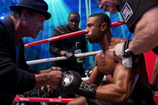 "Rocky Balboa (Sylvester Stallone, left) psychs up Adonis Creed (Michael B. Jordan) in the ring in ""Creed II."""