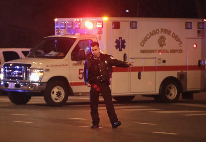 Police secure the scene near Mercy Hospital after a gunman opened fire in Chicago, Illinois.