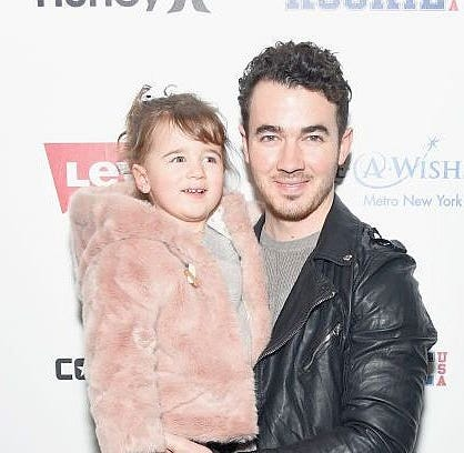 Kevin Jonas holds his oldest daughter, Elena Rose.