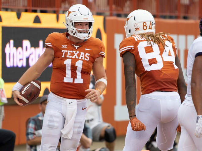 Texas quarterback Sam Ehlinger (11) celebrates with wide receiver Liljordan Humphrey after a touchdown against TCU.