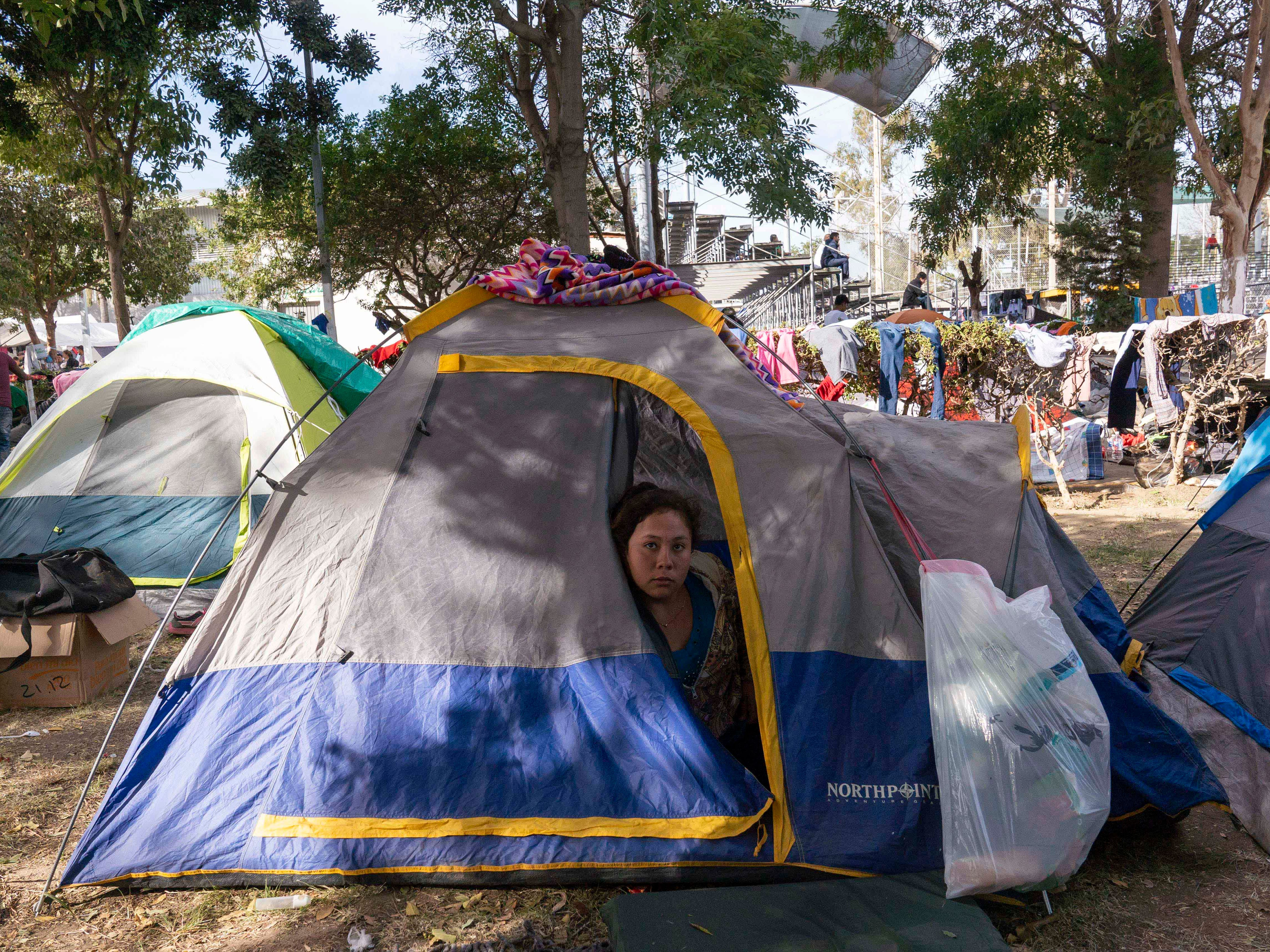 Over 2,500 mostly Central American migrants are currently staying at the Unidad Deportiva Benito Juarez, a makeshift shelter, in Tijuana, Mexico on Nov. 18, 2018. Migrants set up camp around the baseball stadium, propping up tents using whatever materials they have available. Bathrooms and outdoor showers were installed in the outfield.