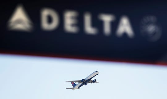 A Delta Air Lines crew detained a passenger who tried to enter the cockpit in an incident that forced a New York-bound plane to return to Puerto Rico on Wednesday, authorities said.