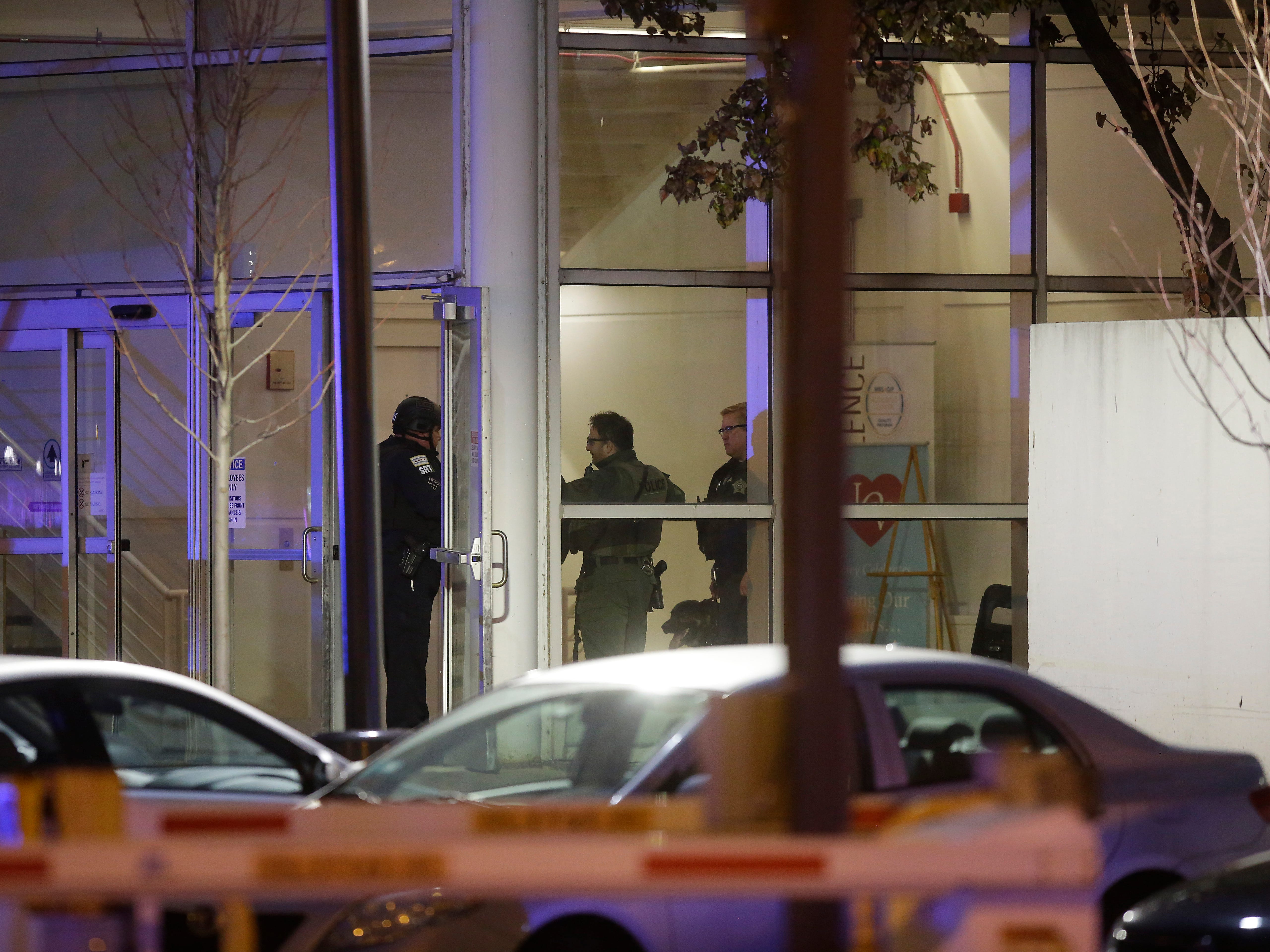 Police officers stand at one of the entrances to Mercy Hospital after a gunman shot multiple people on Nov. 19, 2018 in Chicago.