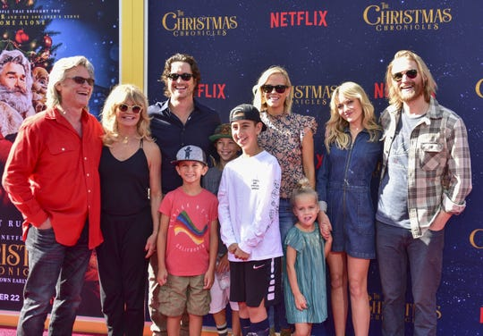 "Kurt Russell (from left), Goldie Hawn and their family attend the L.A. premiere of ""The Christmas Chronicles."" When son Wyatt (far right) was a boy, Russell once posed as a mall Santa."