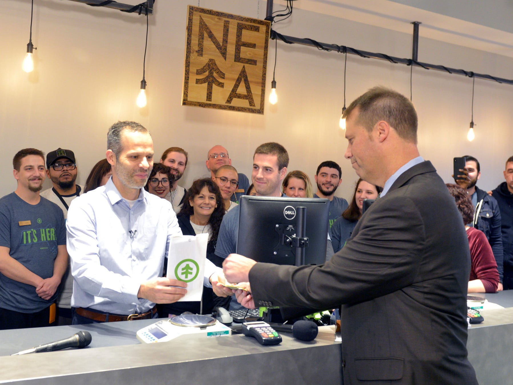 New England Treatment Access co-founder Arnon Vered sells Northampton Mayor David Narkewicz the first legal recreational sale of marijuana at the NETA facility on Tuesday, Nov. 20, 2018, in Northampton, Mass.