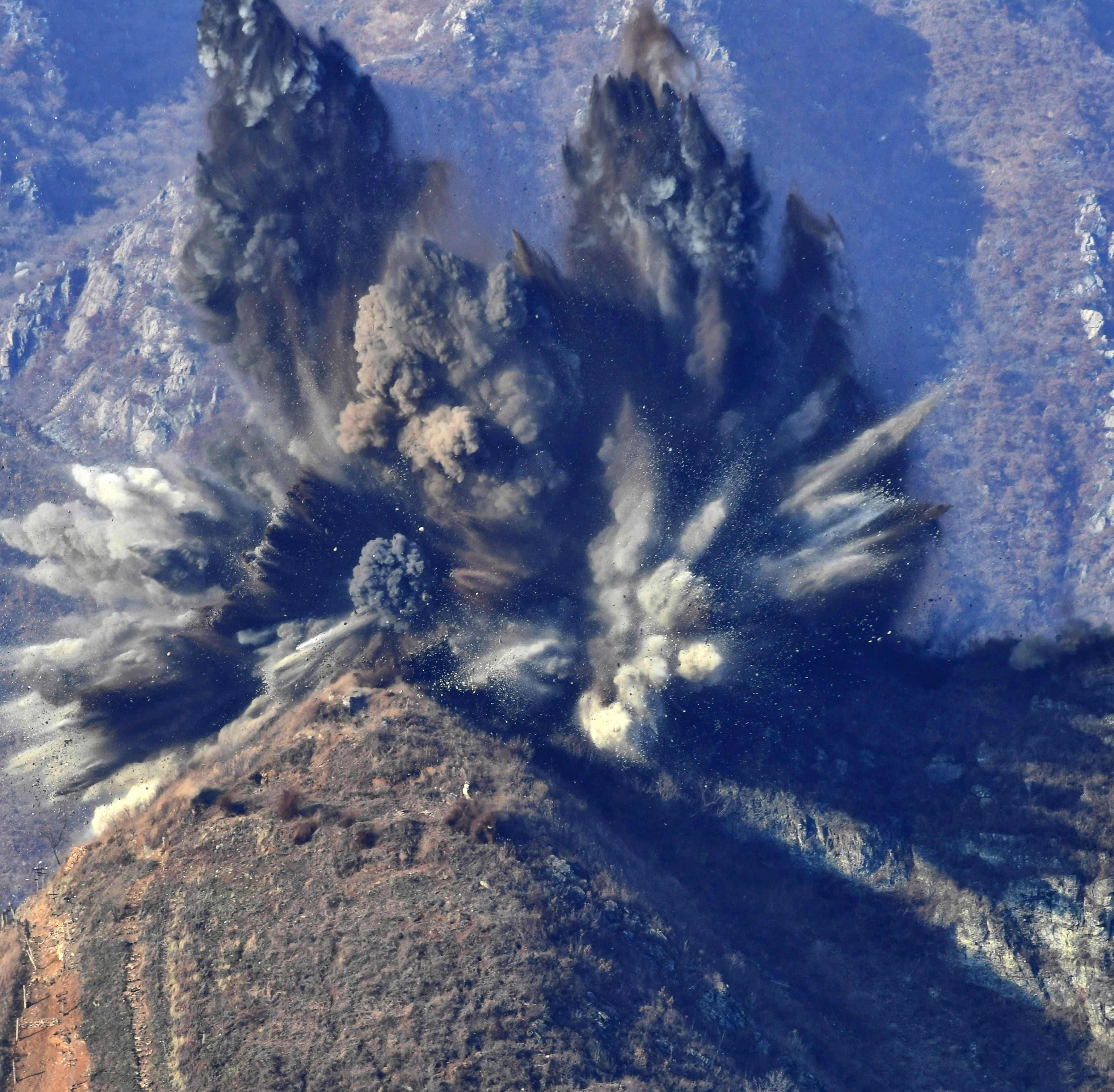 North Korea blows up 10 guard posts to ease tensions with South