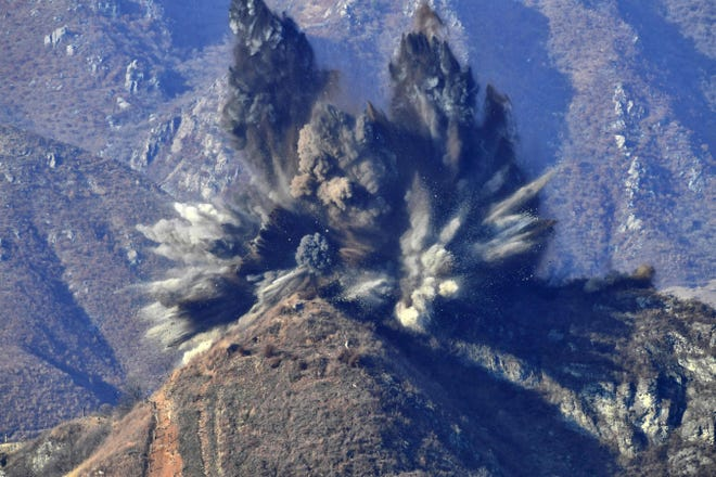 This handout photo provided by the South Korean Defense Ministry in Seoul and taken on November 20, 2018 shows a North Korean guard post being blown up in the Demilitarized Zone (DMZ), as seen from the  South Korean border observatory. Pyongyang blew up 10 guard posts in the Demilitarized Zone on November 20 as the two Koreas pursue a reconciliation drive, even while denuclearisation talks stall between the U.S. and the North.