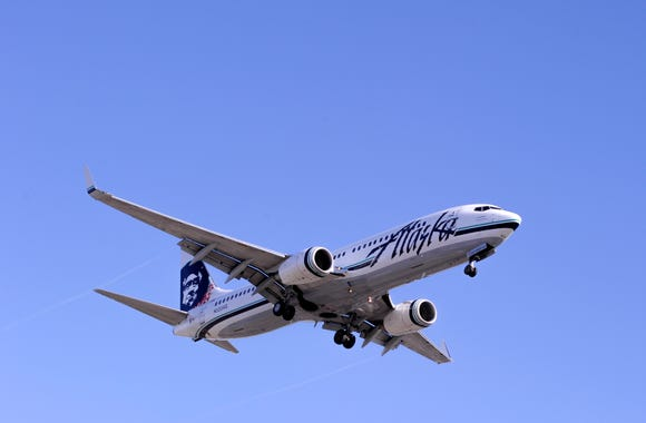 This file photo from September 2014 shows an Alaska Airlines Boeing 737 on approach to Los Angeles International Airport.