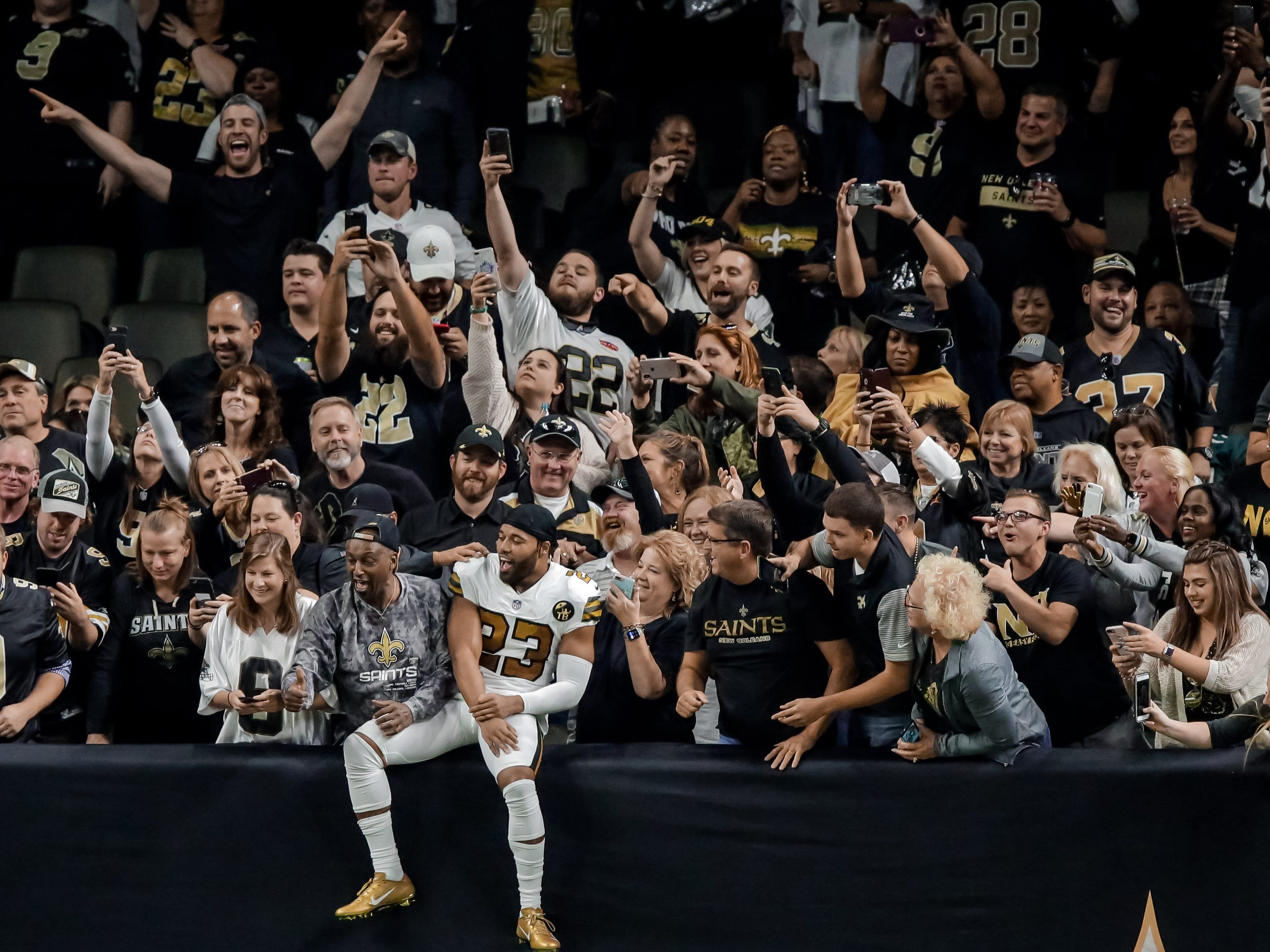Week 11: New Orleans Saints cornerback Marshon Lattimore jumps into the stands to celebrate with fans after a Philadelphia Eagles turnover during the fourth quarter at the Mercedes-Benz Superdome. The Saints won the game, 48-7.