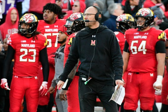 Maryland interim head coach Matt Canada stands with his team during the fourth quarter against Ohio State.