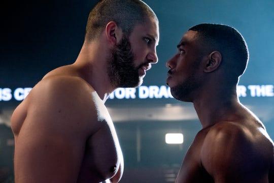 "Viktor Drago (Florian Munteanu, left) and Adonis Creed (Michael B. Jordan) face off in the sequel ""Creed II."""