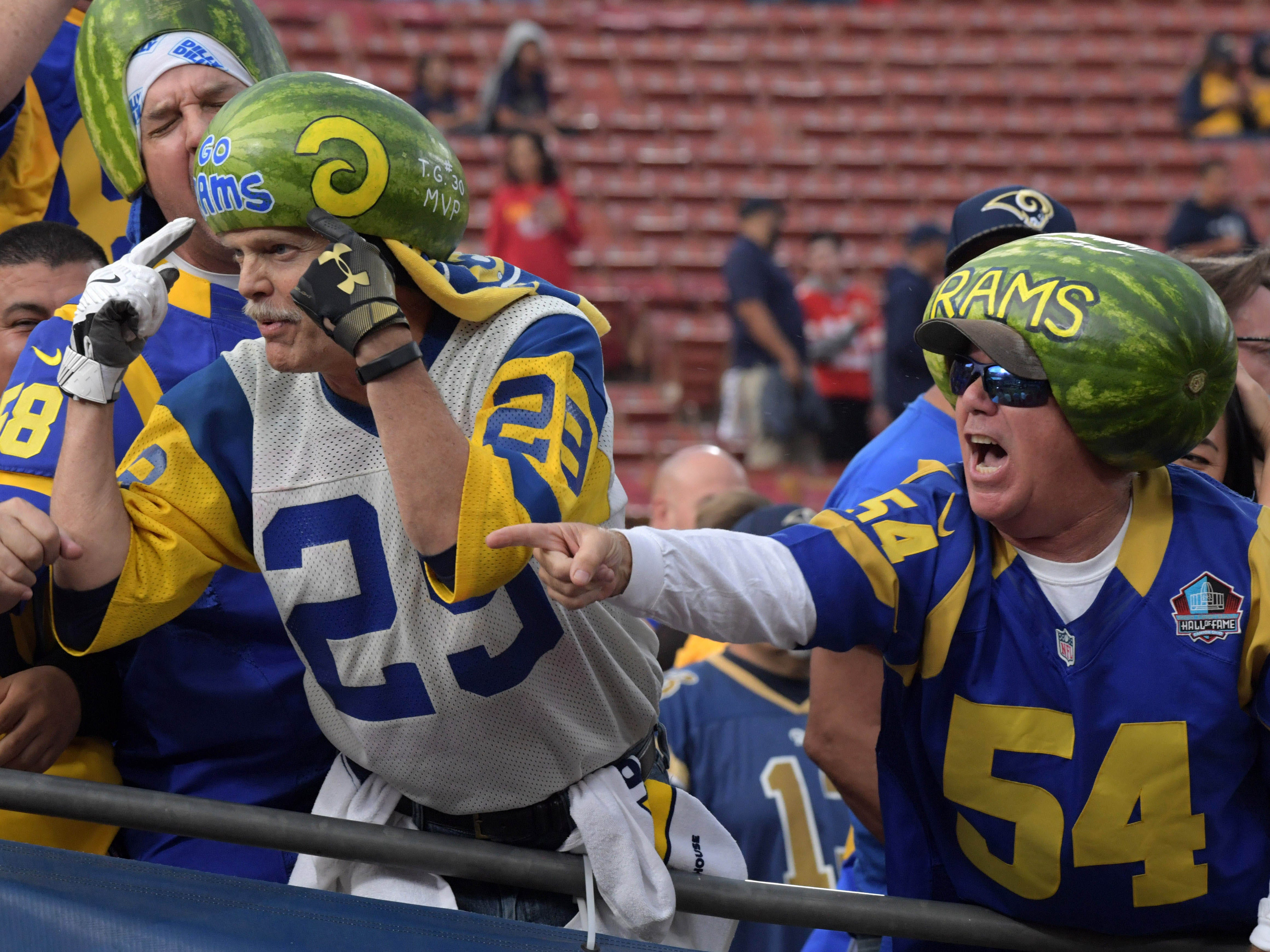 Los Angeles Rams fans wear watermelons on their heads prior to the Rams' game against the Kansas City Chiefs at the Los Angeles Memorial Coliseum.