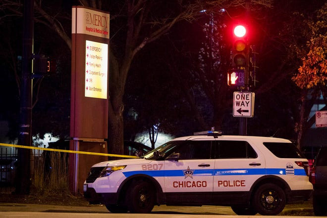 Police secure the area around Mercy Hospital and Medial Center in Chicago on Nov. 18, 2018, after a shooting that left four dead.