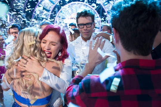 Sharna Burgess and Bobby Bones come off the dance floor victorious.