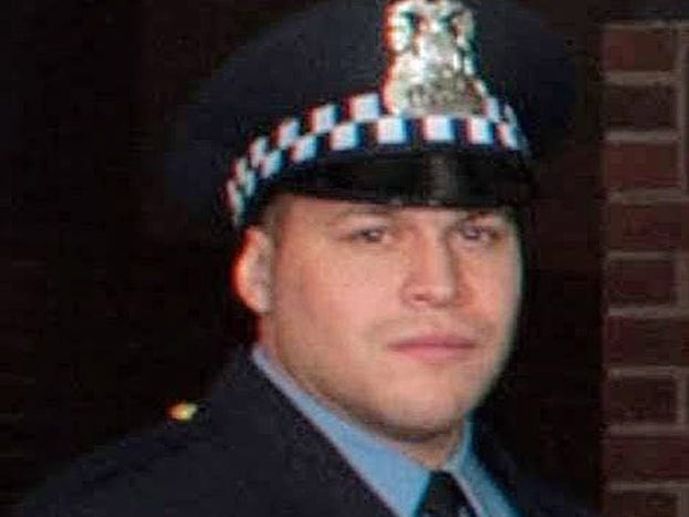 An undated handout photo made available by Chicago Police Department shows Chicago Police Officer Samuel Jimenez. Officer Jimenez was shot and killed after an armed man entered Mercy Hospital and Medical Center in Chicago, Nov. 19, 2018.