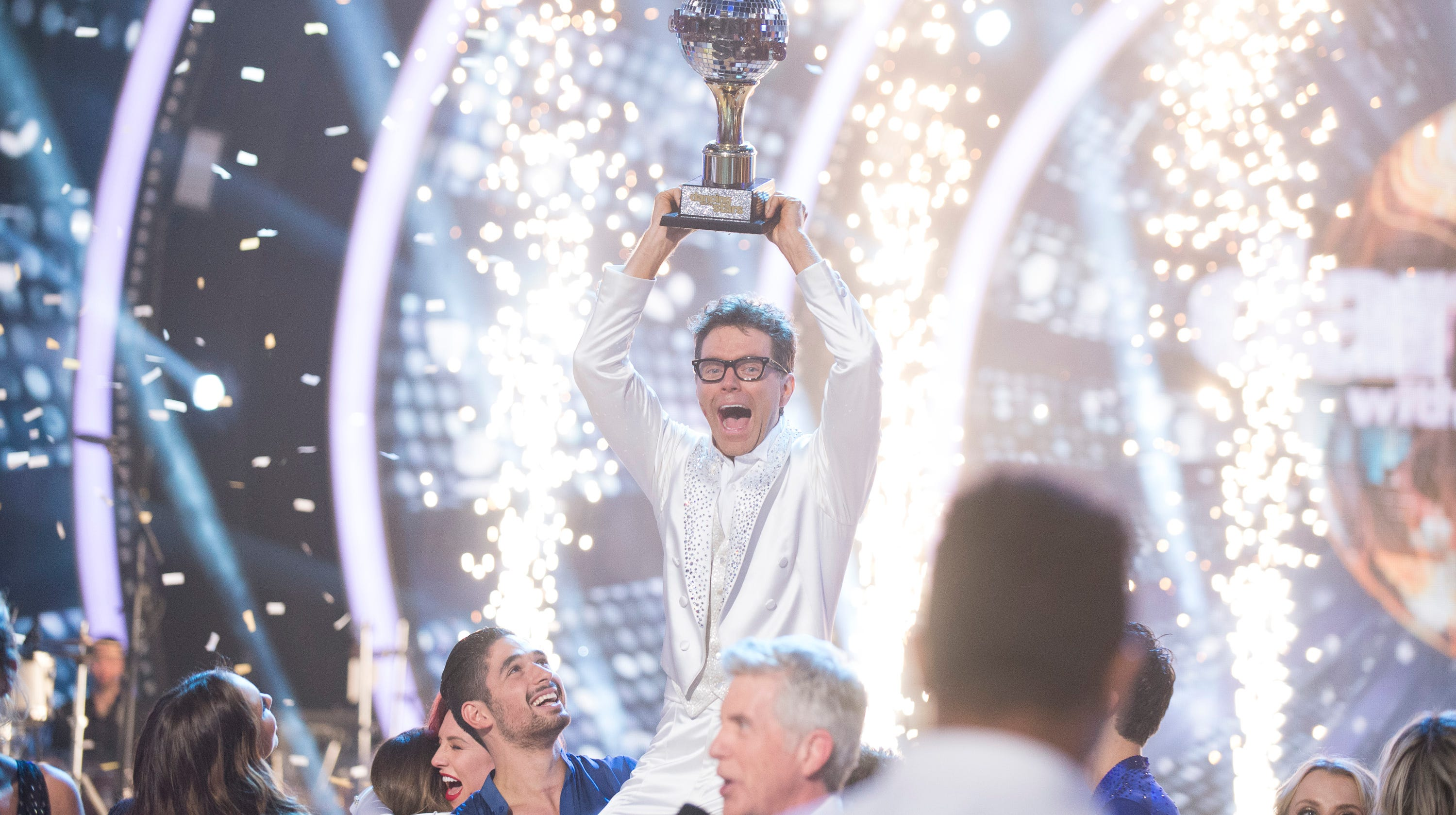 """Bobby Bones hoists the mirrorball trophy on """"Dancing With the Stars."""""""