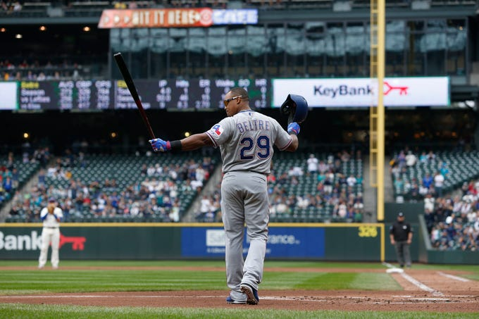 Texas Rangers third baseman Adrian Beltre acknowledges the crowd before the final at bat of his 21-year career. Beltre singled earlier in the game to give him 3,166 hits for his career, which ranks 16th all-time.