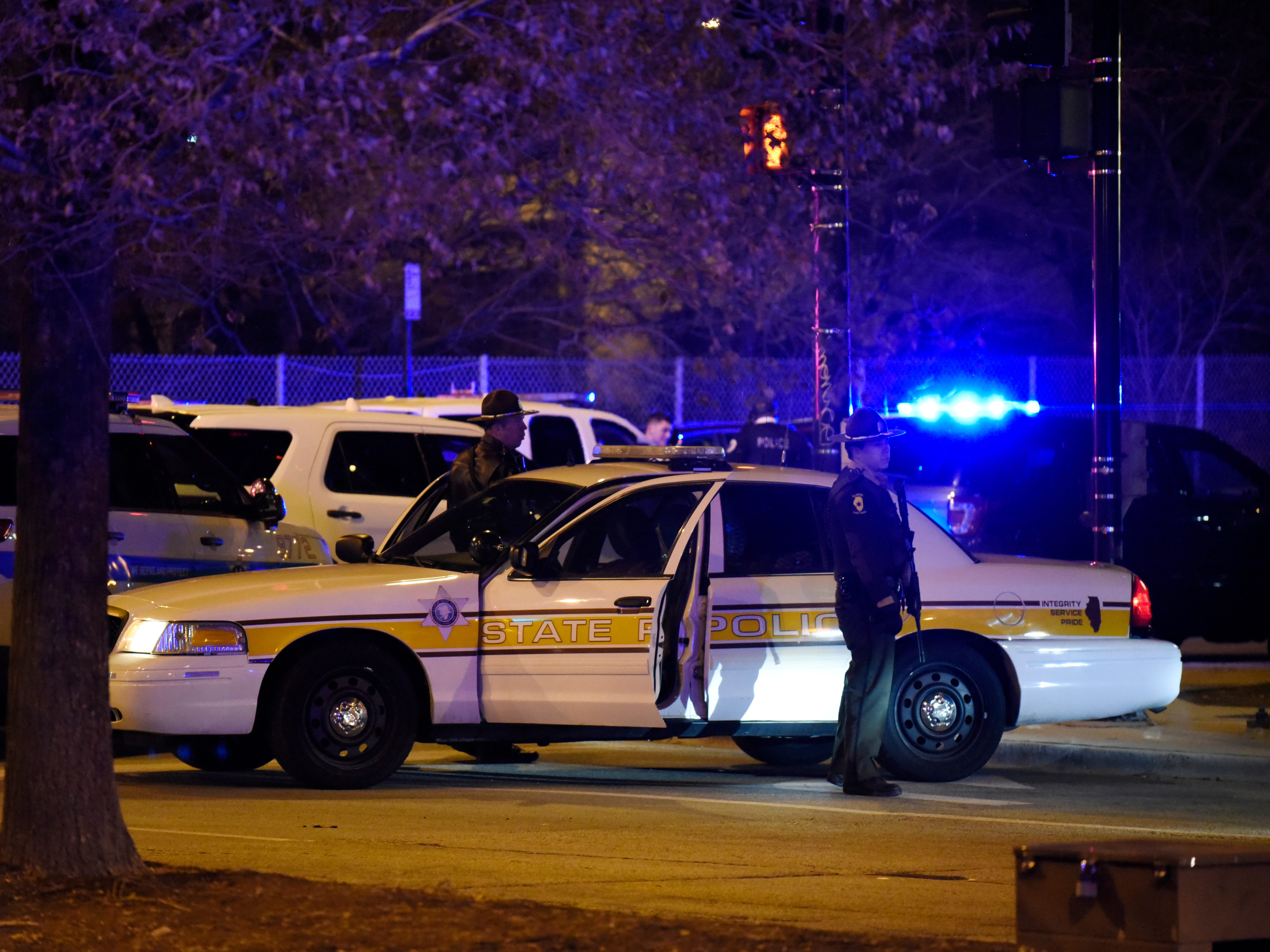 Chicago Police work the scene after a gunman opened fire at Mercy Hospital, on Nov. 19, 2018, in Chicago.